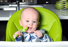Baby awaiting lunch Stock Photography