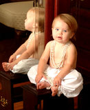 Baby Baby. Baby looking at camera with reflection in mirror Stock Image