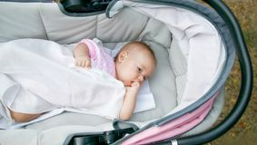 Baby in baby carriage. Oudoor Royalty Free Stock Photo