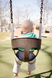 Baby in a Baby Swing Stock Photos