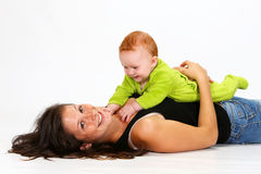 Baby and Babysitter. Babysitter playing with a baby Royalty Free Stock Image