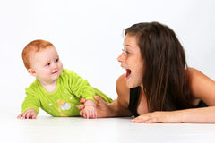 Baby and Babysitter. Babysitter playing with a baby Royalty Free Stock Photography