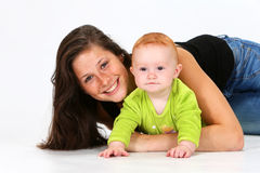 Baby and Babysitter. Babysitter playing with a baby girl Royalty Free Stock Photos