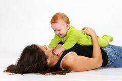Baby and Babysitter. Babysitter playing with a baby girl Stock Images