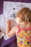 Baby back painting white sheets Royalty Free Stock Images