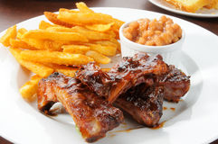 Baby back ribs and fries Stock Photography