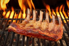 Baby Back Or Spare Ribs On The Flaming BBQ Grill Royalty Free Stock Photos