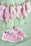 Baby background toddler shoes on vintage background Stock Photos