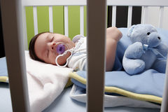 Baby in bad Stock Image