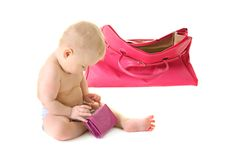 Baby with a bag Royalty Free Stock Image
