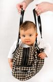 Baby in the bag. Small baby girl in the hanging inside of the bag Royalty Free Stock Photography
