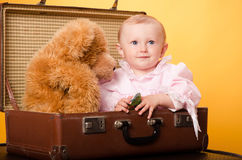 The baby in the bag, studio Royalty Free Stock Image