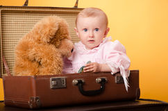 The baby in the bag, studio Royalty Free Stock Photography