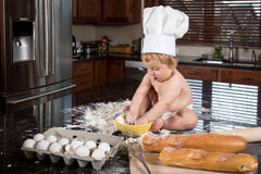Baby Baker Sitting in Kitchen Stock Photography