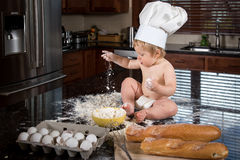 Baby Baker Sitting in Kitchen Royalty Free Stock Photography