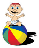 Baby on ball. Cute baby sitting on ball Stock Photo