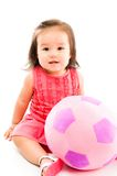 Baby and Ball. Beautiful Baby with a plush ball on white background Stock Images