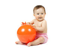 Baby with the ball. Baby with the orange ball on the white background Stock Images