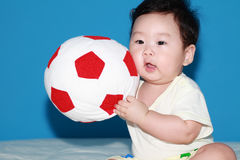 Baby with Ball. Asian Baby boy playing with ball Stock Photo