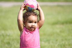 Baby and a ball. A determined baby throwing a ball Stock Photos