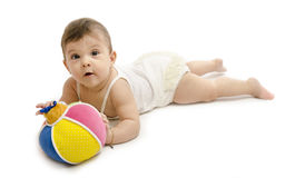 Baby and ball. Isolated baby playing with colorful ball on white Royalty Free Stock Image