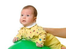 Baby on ball for massage. Isolated Stock Photo