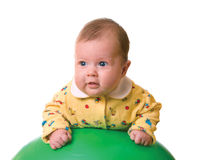 Baby on ball for massage Royalty Free Stock Photography