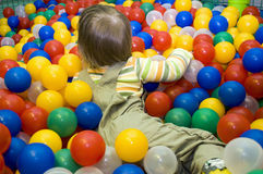 Baby in ball pit. Baby girl in ball pit Royalty Free Stock Image