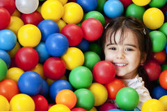 Baby in a ball's sea. Young woman portrait in a ball's sea Stock Images