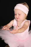 Baby Ballerina. Catching a single floating bubble Royalty Free Stock Image
