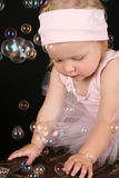 Baby Ballerina. Playing amongst lots of bubbles Royalty Free Stock Photos