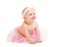 Baby Ballerina. Very cute happy baby girl wearing ballerina skirt. Isolated on white Stock Image