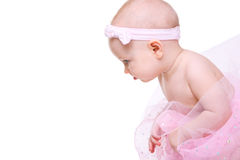 Baby Ballerina. Very cute happy baby girl wearing ballerina skirt. Isolated on white Royalty Free Stock Photography