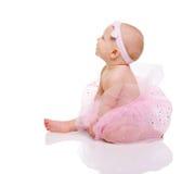 Baby Ballerina. Very cute happy baby girl wearing ballerina skirt. Isolated on white Stock Photos
