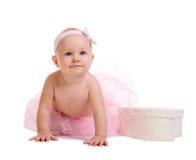 Baby Ballerina. Very cute happy baby girl wearing ballerina skirt. Isolated on white Royalty Free Stock Image