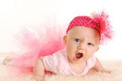 Baby Ballerina Game face. Cute young infant girl in a pink tutu and head band with an angry game face Stock Image