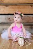 Baby ballerina. Wearing a white tutu and pink bodysuit Royalty Free Stock Image