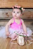 Baby ballerina. Wearing a white tutu and pink bodysuit Stock Image