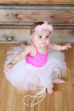 Baby ballerina. Wearing a white tutu and pink bodysuit Stock Photo