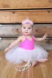 Baby Ballerina. Wearing a white tutu and pink bodysuit Royalty Free Stock Photography