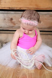 Baby Ballerina. Wearing a white tutu and pink bodysuit Royalty Free Stock Photos