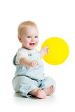 Baby with ballon in hand. Smiling baby boy  with yellow ballon in his hand isolated on white Stock Photo