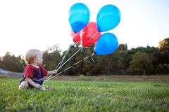 Baby with Balloons Stock Photo