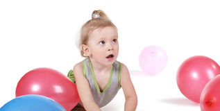 Baby with balloons Stock Images