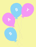 Baby Balloons. In pink and blue over yellow background Royalty Free Stock Photo