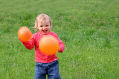 Baby and balloons stock image