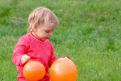 Baby and balloons Stock Images