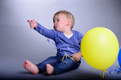 Baby with balloons Royalty Free Stock Photos