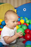 Baby in balls Stock Image