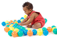 Baby with balls Stock Images